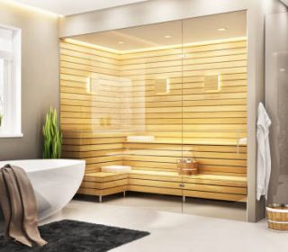 Beautiful bathroom with white bath and sauna and shower in a modern home