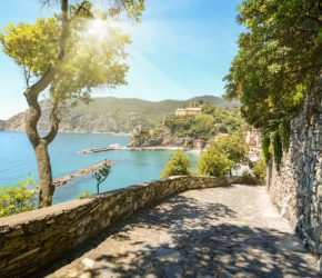 View from hiking trail to beautiful coastline and beach of mediterranean sea near village Monterosso al Mare in early summer, Cinque Terre Liguria Italy Europe