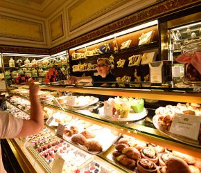 A shop assitant stands in the pasticceria Cova in Via Montenapoleone in Milan, the day after it was announced that LVMH, the world's largest luxury goods group, bought a majority stake in the company on June 28, 2013. LVMH said they will develop the brand internationally. AFP PHOTO / GIUSEPPE CACACE        (Photo credit should read GIUSEPPE CACACE/AFP via Getty Images)