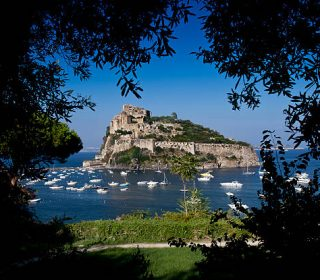 A freak of nature, a treasure trove of history. The Castello Aragonese is easily the most impressive historical monument in Ischia. It stands on a volcanic rock connected to the island by a bridge built in 1438 by Alfonso of Aragon. The Castle, overlooking the vast horizon of the sea, was originally built as a castrum in 474 BC by Gerone of Siracusa and, after a long period of abandonment, reached its golden period during the fourteenth century.  Under the Aragonese dynasty, it became a political, cultural and spiritual centre of notable interest. The Renaissance court of the noble poet Vittoria Colonna, saw the peak of the castle's splendour. Her court raised the Castello to heights of unheard glory: it breathed new life into the place; the arts and sciences flourished as never before under these skies - even Michelangelo was enticed here - but the decline had already begun in the 15th century and continued for more than 100 years.