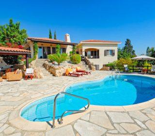Private swimming pool and patio area outside Cyprus villa