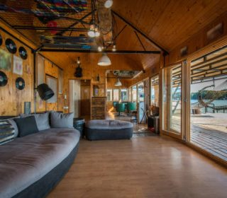 Luxury log cabin house living room with large windows
